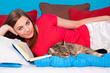 bedtime 19/girl with book and cat in bed