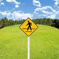 Crossroad sign with green golf course background