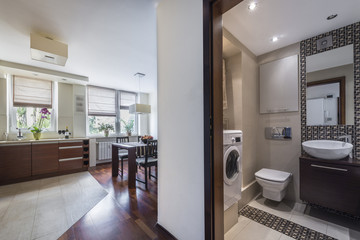 Modern home interior with kitchen and bathroom