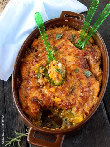 Baked beans and pumpkin with aromatic herbs