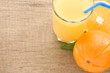 fresh fruits orange juice in glass on wood