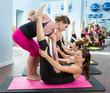 Aerobics Pilates personal trainer helping women group
