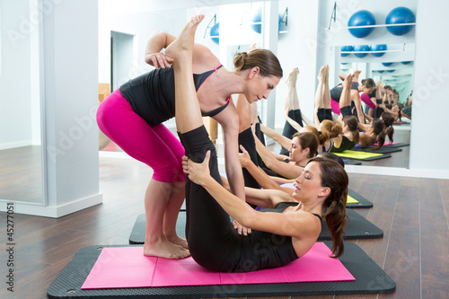 Aerobics Pilates personal trainer helping women group