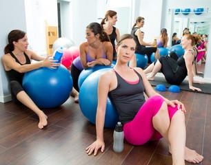 Aerobics pilates women group having a rest at gym