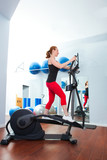 Aerobics cardio training woman on elliptic crosstrainer