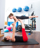 Aerobics woman personal trainer of children girl balance