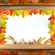 Frame with autumn colorful leaves and brick wall