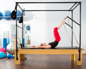 Pilates aerobic instructor woman in cadillac