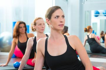 Beautiful women group in a row at aerobics class