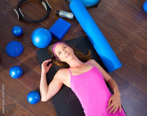 Aerobics woman tired resting lying on mat
