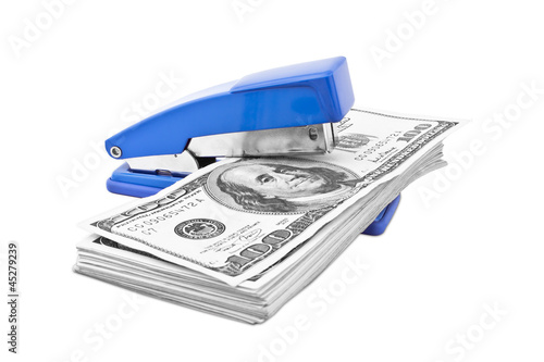 hundred dollar money pile with stapler