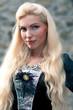 Beautiful girl wearing a medieval dress.