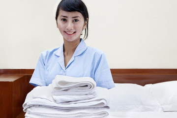 Hotel maid in a hotel room