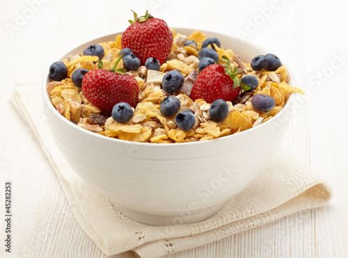 Bowl of healthy muesli and fresh berries