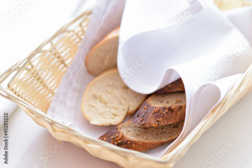 slices of bread in a wicker basket