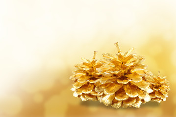 Golden pine cone isolated on white
