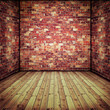 Abstract interior with old brick wall and wooden floor
