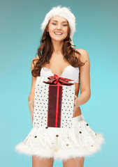 santa helper girl in lingerie with gift box