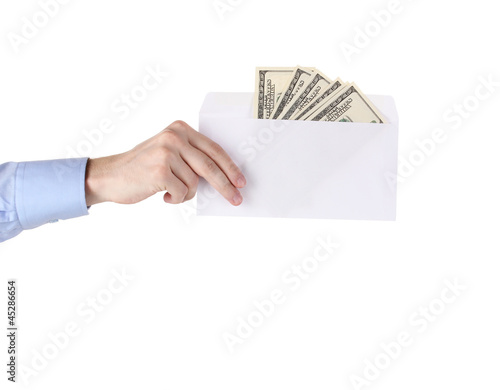 man's hand holding an envelope with dollars on white background