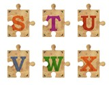 Old grunge cardboard jigsaw puzzle pieces with alphabet, Part 4