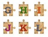 Old grunge cardboard jigsaw puzzle pieces with alphabet, Part 2