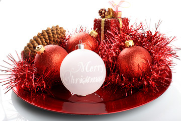 Christmas decorations on red plate