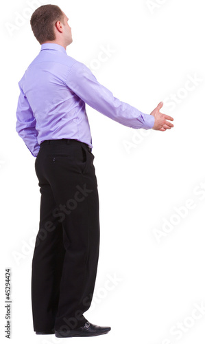 back view of business man in shirt shake hands