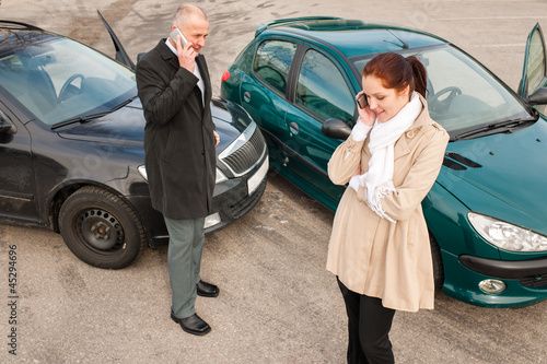 Woman and man on phone car crash