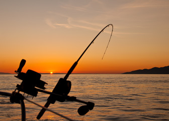 Down Rigging Fishing Rod At Sunset