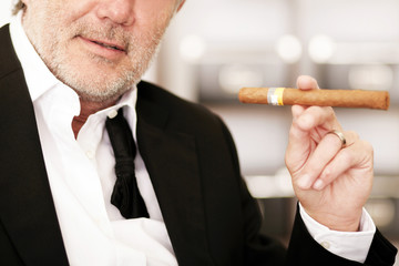 Geschäftsmann mit Zigarre