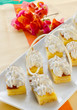Square mini sponge cakes with merengue