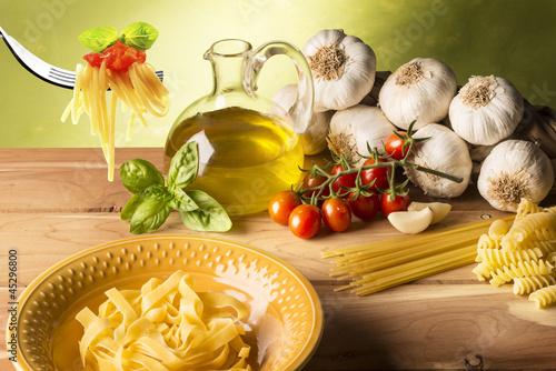 stil life with olive oil,vegetables on wood table