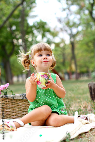 Caucasian little girl eating sweets
