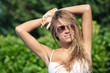 Young beautiful blonde woman portrait with sunglasses.