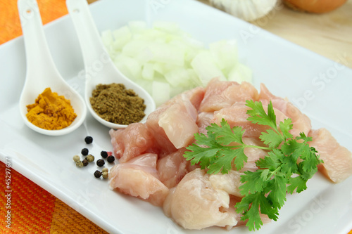 Uncooked diced chiken breast and other ingredients