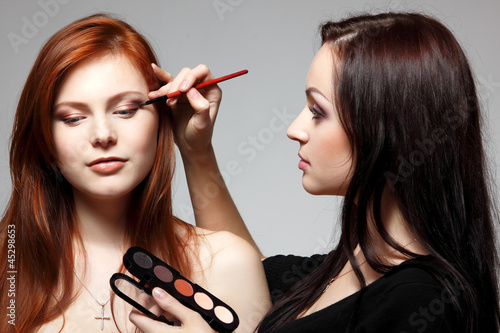 poster of Portrait of beautiful young redheaded woman with esthetician mak