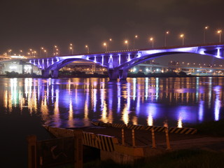 Highway bridge with purple light at night