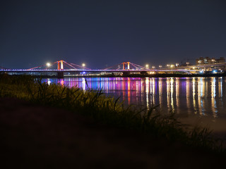 A red highway bridge with light at night