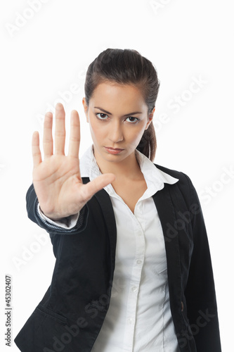 Asian Businesswoman with stop hand left