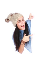 Emotion smiling teenage girl point finger on billboard against