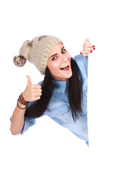 smiling woman leaning on white board with thumbs up