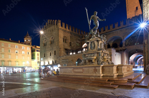 Fountain of Neptune at night time in Bologna. Italy.