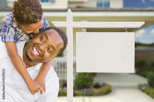 African American Father and Mixed Race Son In Front of Blank Rea