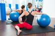 stability ball in women Pilates class rear view