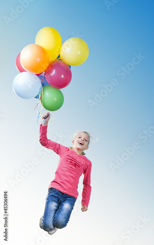 Girl playing outside with balloons