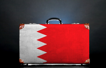 The Bahraini flag on a suitcase for travel.
