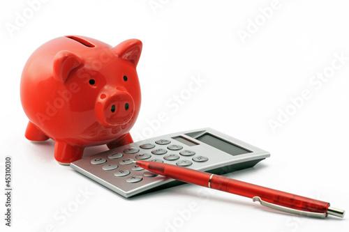 Leinwanddruck Bild sparschwein mit tschenrechner