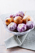 Garlic bulbs and onions in a bowl