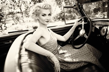 Retro woman in convertible