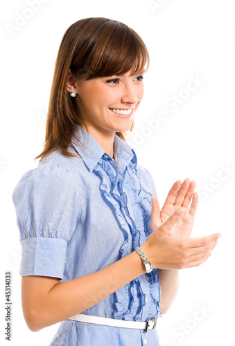 Cheerful clapping businesswoman